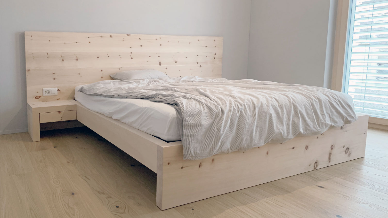 Bed made of Swiss stone pine wood by Holzer & Bott in Zuoz, Engadin, Swiss Made