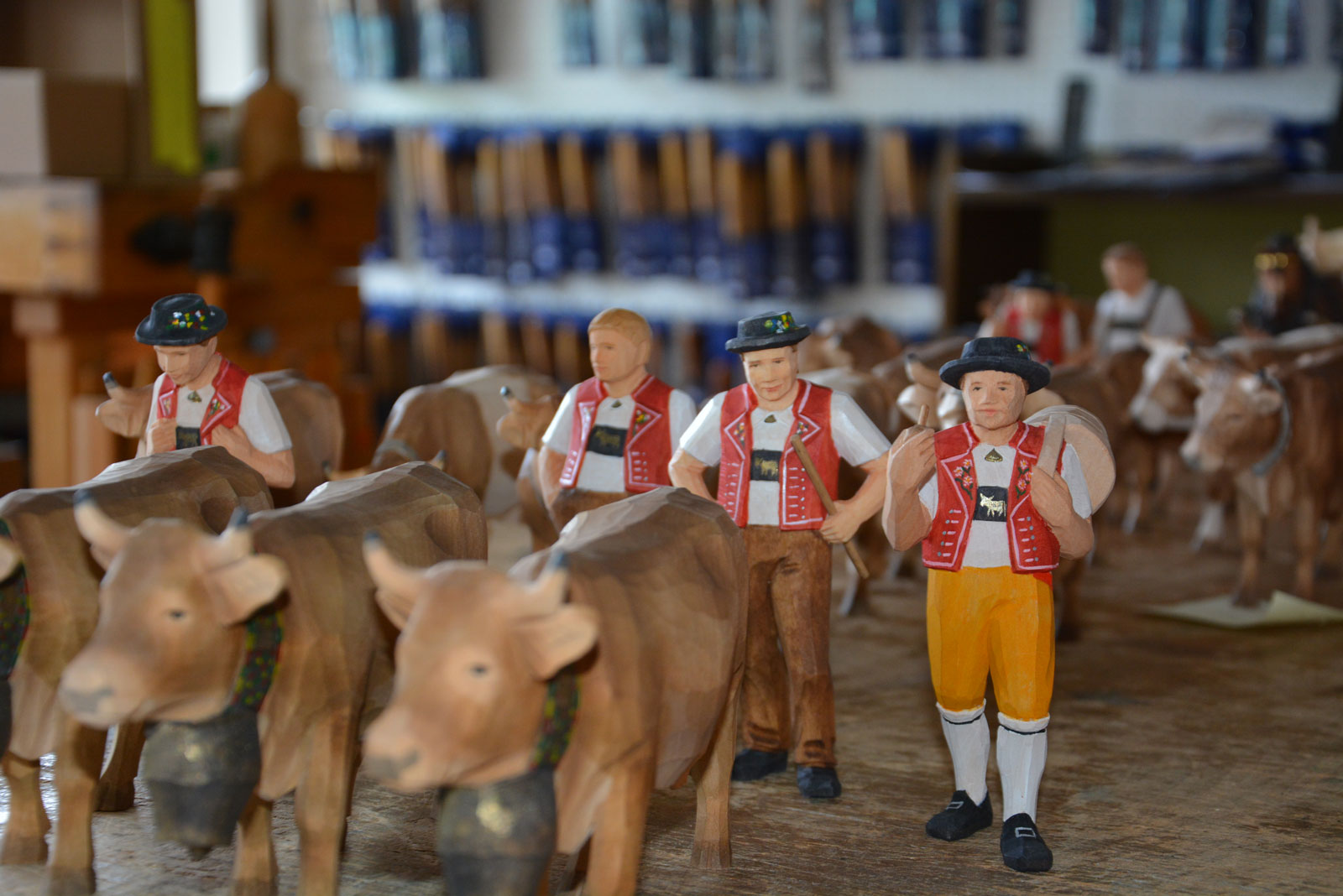 Swiss cows and traditional costumes carved from wood